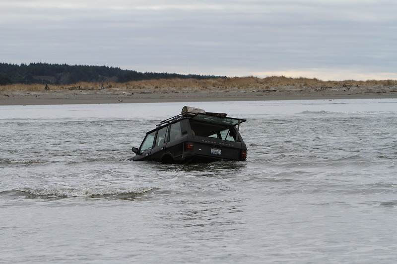 Unfortunately they could not tow the Land Rover out during high tide as the 4WD's  owner left it running and the engine sucked in a bunch of salt water, seizing up the transmission.