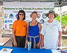 Dottie Olszyk, Lisa Gregory and Linda Jacobson greet attendees