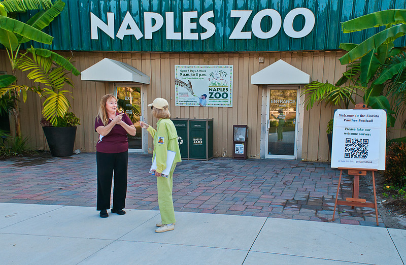 Volunteers compare notes before the Florida Panther Festival at the Naples Zoo
