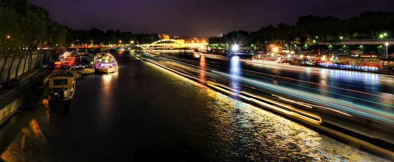 The busy Seine at night