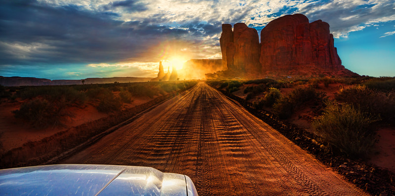 Driving into the Monument Valley sunset