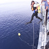 a canadian naval ships team diver takes a leap into the ocean during a naval exercise with the nato standing naval fleet atlantic (stanavforlant)<br /> Photo imaging services halifax 1999