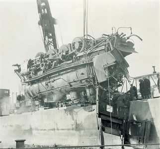 August 1953Train recovery from Halifax Harbour. Stan Stephenson helped a civvy diver put sling on Forward Drive Wheel
