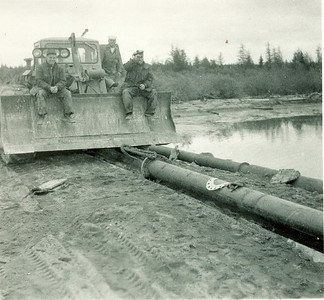 1958Oil pipeline (P.O.L.) built by RCN Divers and the Americans at Goose Bay, Labrador. Stan Stephenson driving!