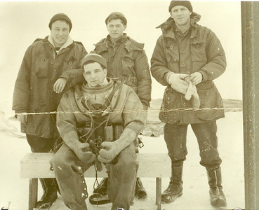 Lake Winnipeg, December 1955T-33 Jet Aircraft RecoveryL to R: Rocky Verscheure, Bobby Thompson, & Guy Fenn in back row.Ed Dalton seated in front - dressed