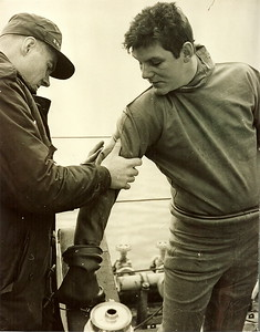 "Taken aboard HMCS LABRADOR in the ArcticBruce Robinson (L) 7 Dave Pilot (R) Dressing in the old Pirelli Suit ""A Patch in Time"""