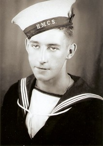 "The first photo of Patrick in his uniform was most likely taken during WW II due to his cap tally showing ""HMCS"", which was the one used during the War so the enemy didn't know what ship he was from if he was captured.  Additionally, Patrick would have been either an AB(Able Seaman) or an LS(Leading Seaman)at the time the photo was taken due to the uniform he was wearing."