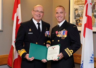 ENGLISH   HS2012-0676-017  21 June 2012  Halifax, Nova Scotia    Rear Admiral David Gardam (left) Commander of Maritime Forces (Atlantic) (MARLANT) and Joint Task Force Atlantic (JTFA) presents Lieutenant-Commander (LCdr) Stephan Julien (right) with The Bronze Star Medal for exceptionally meritorious service as the operations, training and Afghanistan National Security Forces partnership officer for the counter improvised explosive device branch during Operation Enduring Freedom. This presentation took place in building D201, Canadian Forces Base Halifax (CFB Halifax).    Photo Credit: Corporal Martin Roy Formation Imaging Services, Canadian Forces Base Halifax © 2012 DND-MDN Canada