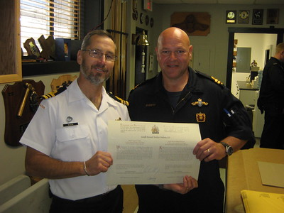 Wlater Gets His Commissioning Scroll