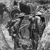 Australian troops enter a German trench during WWI.