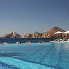 Infinity pool overlooks iconic Los Arcos.