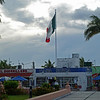 The Mexican flag flys over the town square.