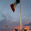 The Mexican flag flys at sunset.