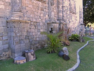 Dauin church stonework and grounds.