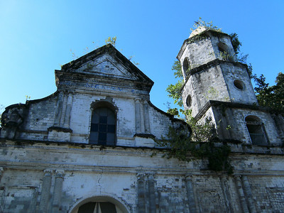 Church front with overgrowth.