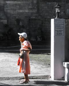 Parishoner at the gate.