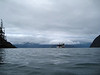 """View of the boat from """"The Shackle"""" dive site.  Those are open water students doing their second dive, in drysuits!"""