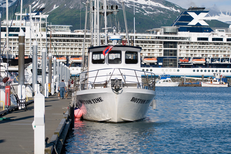 """""""Bottom Time"""" dive boat, in Seward harbor, with a visiting cruise ship in the background (some cruises originate in Seward).  Photo taken around 8pm at """"night"""", the night before the first dive.  Bottom Time is operated by Dive Alaska, Inc., based in Anchorage, and is the only commercial dive boat operating in Resurrection Bay, Alaska.  (Photo by Jonathan Rodda)"""