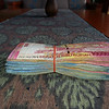 """This is a 2"""" stack of Indonesian bills (notice the 100,000 bill on top). With a currency exchange of $1 US dollar = 10,000 rupiah you can see how that can add up. This was my dive/eat/sleep/transport bill which is roughly $100 per day inclusive"""