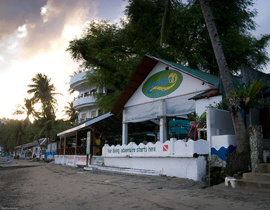 Amgelyn's hotel from beach - left of dive shop (not the one I used) is the restaurant.  Pleasant eating environs.