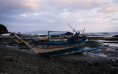 Boat at dusk - again Lightroomed.  All boats seem to be narrow hulled with bamboo outriggers for stability.
