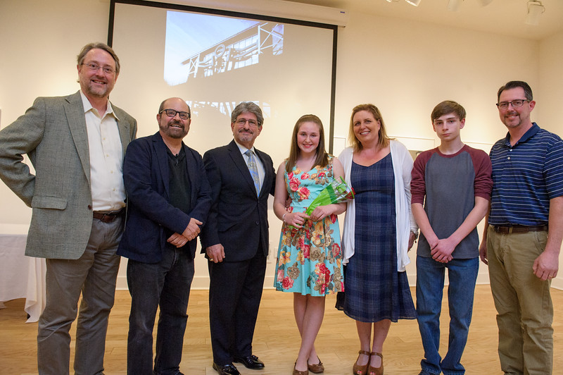 """5/1/16 FITCHBURG-- Left to right; Museum Director Nick Capasso, Artist Douglas Kornfeld, Fitchburg Mayor Stephen DiNatale, essay winner Alyssa St. Cyr, mother Kara St. Cyr, brother Tyler St. Cyr and father James St. Cyr of Fitchburg after Capasso announced Alyssa as the winner of the Name This Sculpture Contest granting her the honor of naming Kornfeld's creation """"Thurston""""  after cythe maker and artist Asa Thurston.  SENTINEL & ENTERPRISE/Jeff Porter"""