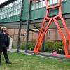 """5/1/16 FITCHBURG-- Artist Douglas Kornfeld and Alyssa St. Cyr of Fitchburg, writer of the winning essay """"Thurston"""" look up at the sculpture on Sunday at the Fitchburg Art Museum.  SENTINEL & ENTERPRISE/Jeff Porter"""