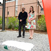 """5/1/16 FITCHBURG-- Artist Douglas Kornfeld and writer of the winning essay Alyssa St. Cyr of Fitchburg stand underneath the sculpture to reveal a plaque which display's it's name as """"Thurston.  It also describes the art and the origins of it's name.  SENTINEL & ENTERPRISE/Jeff Porter"""