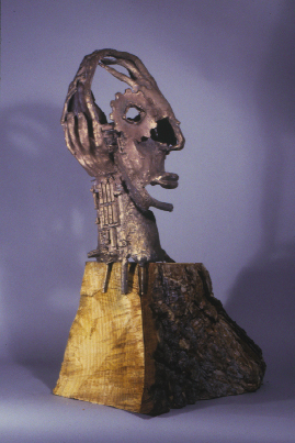 """<h2>Thinking Nature</h2>cast bronze and wood 27"""" x 18"""" x 10"""" August, 2000 consists of gears, circuit boards, tree branch and tree bark, cast from life"""