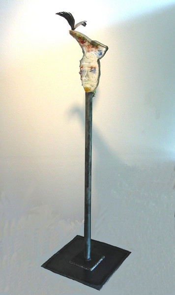"<h2>Fleeting Thoughts</h2>cast glass, steel,  electric lighting fixture 70"" x 20"" x 20"" April, 2003 This was created for a group show at Gallery Fraga on Bainbridge Island, Washington.  The show was called ""If the Show Fits.."" and the displayed artwork addressed shoe themes!  I created a glass head with a formal dress shoe planted on top.  Steel wings illustrate the intention of ""fleeting thoughts""!"