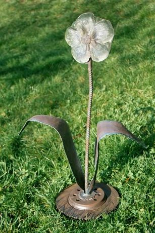 "<h2>Constructed Flower with Transistor</h2> cast glass and welded reclaimed steel 31"" x 20"" x 12"" December, 2001 How are the human-made and the natural intersecting- will we have electronic flowers? The caterpillar-like transistor can be seen mounted on right side of the flower."