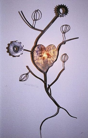 "<h2>Heart with Branches</h2>cast glass, steel, and electric light 38"" x 25"" x 10"" March, 2001 Intersecting flower and gears with radiating branches create a compassionate tree-like form."