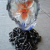 "<h2>Unchained Heart</h2>cast glass and reclaimed steel 10"" x 8"" x 8"" July, 2002 This flowering heart sits emancipated from a pile of chains.  Release the passion!"