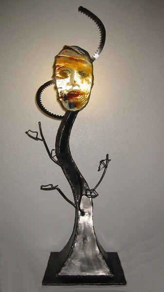 "<h2>Awakening</h2>cast glass, steel, and electric lighting fixture  40"" x 13"" x 12"" July, 2003 Totemic and wise, this sculpture merges natural and industrial forms to create an inspiring and moving statement"