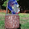"<h2>Radiant Thinker</h2>cast glass with inclusion, welded steel bracket, electric backlight 13"" x 13"" x 4"" December, 2004"