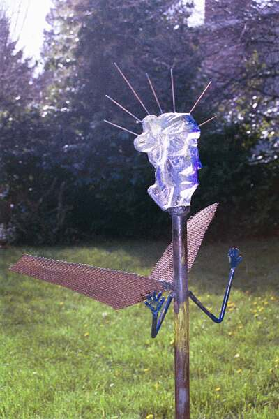 "<h2>Angelic Sentinal</h2>cast glass and steel 54"" x 34"" x  30""  March, 2001"