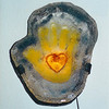 "<h2>Heart in Hand</h2>cast glass, steel, and electric light 23"" x 19"" x 11"" August, 2000"
