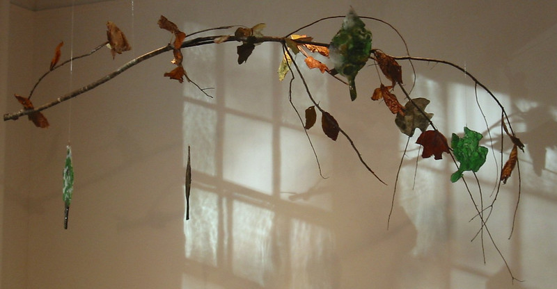 "<h2>Arbor Vitrius Metamorphosis </h2>hanging sculpture recycled glass, leaves and tree branch 72"" x 50"" x 32"" December, 2007"