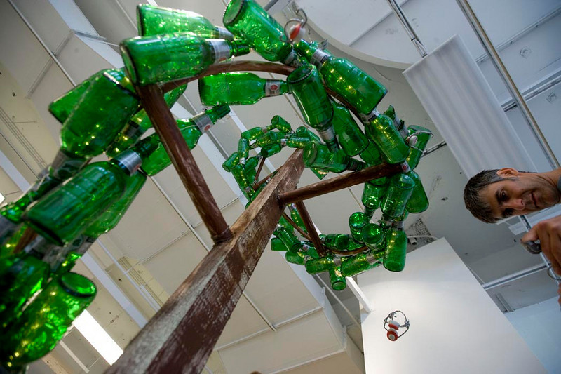 """Grolsch Glass Bottle Spiral Topiary<br /> -detail<br />  for a video of this installation being built go to:<br />  <a href=""""http://www.youtube.com/watch?v=-4eht74NizY"""">http://www.youtube.com/watch?v=-4eht74NizY</a>"""
