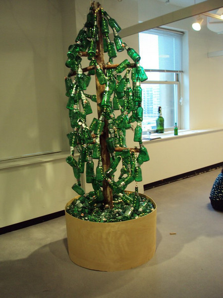 "Grolsch Glass Bottle Conifer Topiary<br /> recycled beer bottles, wood, pvc, wire, rope lighting<br /> 86"" x 36"" x 36""<br /> April, 2009<br /> created for NEXT Art Fair as part of Art Chicago"