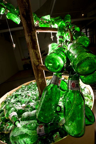 """Grolsch Glass Bottle Spiral Topiary<br /> - detail<br />  for a video of this installation being built go to:<br />  <a href=""""http://www.youtube.com/watch?v=-4eht74NizY"""">http://www.youtube.com/watch?v=-4eht74NizY</a>"""