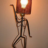 "<h2>Dancing Lady Lamp</h2>Steel and electric lighting fixture 28"" x 10"" x 10"" September, 2002 A whimsical lamp in the form of a dancing lady - this sculpted light is fun and functional."
