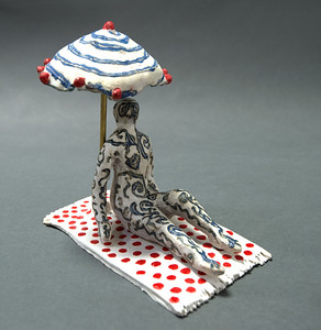 Reclining Figure with Umbrella on Polka Dot Towel