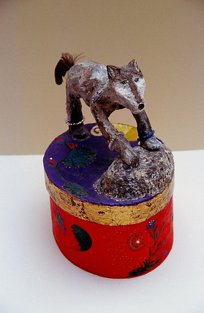 """The Grey Wolf"" 2004, (front view) mixed-media sculpture composed of wire, papier mache, gold leaf, crystals, a feather, a rock and acrylic paint"