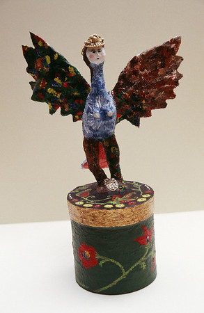 """Sirin, Russian Bird of Paradise"" 2004,  (front view)  mixed media sculpture composed of wire, papier-mache, gold leaf, crystals, jeweled crown and acrylic paint"