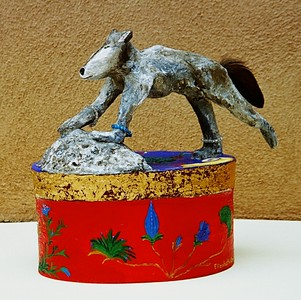"""The Grey Wolf"" 2004, (left-side view) mixed-media sculpture composed of wire, papier mache, gold leaf, crystals, a feather, a rock and acrylic paint"