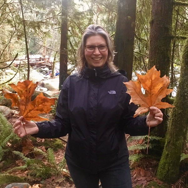 Nina holding leaves of Bigleaf maple (Acer macrophyllum) in Vancouver, Canada, November 2018. Photo by Dr. Holly Martinson.
