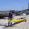 The mud wins ... we move the boats to another launch site ... still very soft, but better. Mark models the appropriate look for a mud launch at Drakes Estero. The mud was so thick that Mark's Keens were sucked right off of his feet! Mud's fun to walk in barefooted, but not when it's laced with broken oyster shells ... ouch!! And digging around in the mud for a missing shoe while standing on sharp shells isn't quite as much fun as digging for clams.