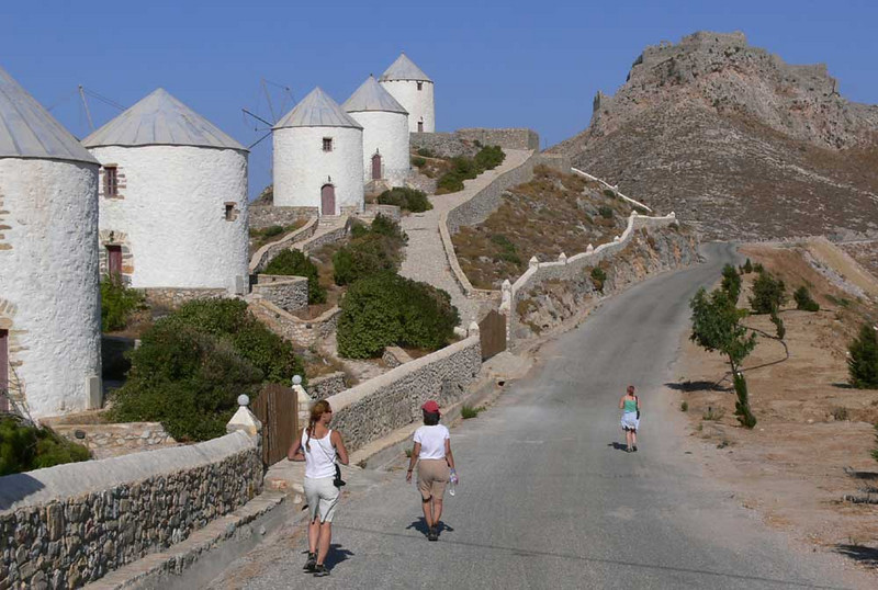 Here we are hiking up to the crusader castle above Pandeli on Leros Island.  The white buildings once were windmills; now they are rooms for rent.