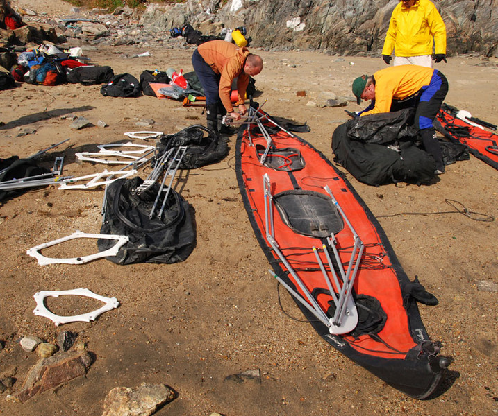We assembled our Feathercraft K2 Expedition double kayaks on the beach in Kuummiut.  The guy in orange is Gunnar Bjorgvinsson, the UTE guide I knew from 2005.  Gunnar speaks Icelandic, English, Danish, Norwegian, etc. and has spent many years guiding kayaking trips in Greenland.